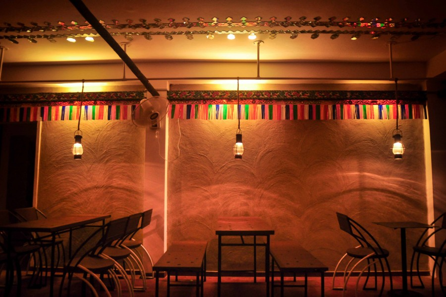 Wall decorated with tassels, tinsel & Hariken light of Rickshaw Art | Haatkhola:  Gallery-Cafe © Arjo Sthapotto