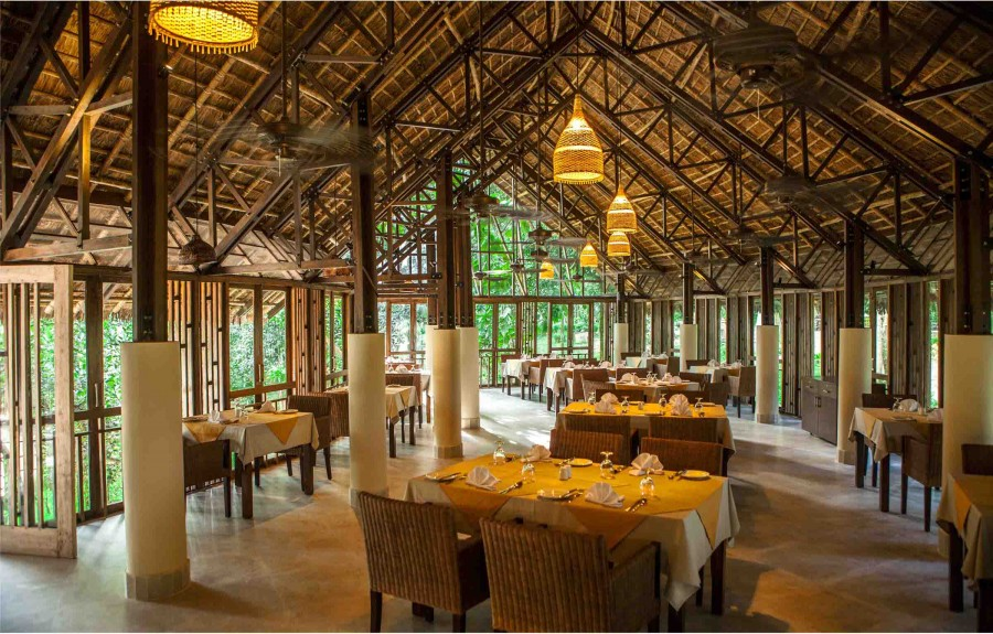 Valley Restaurant Interior: Thatch roof, wood and metal composite truss, wooden frame work all are visible here. Interior decor has been kept to a minimum to emphasize the structure itself. | Photo Courtesy : Ahsanul Haque Rubel