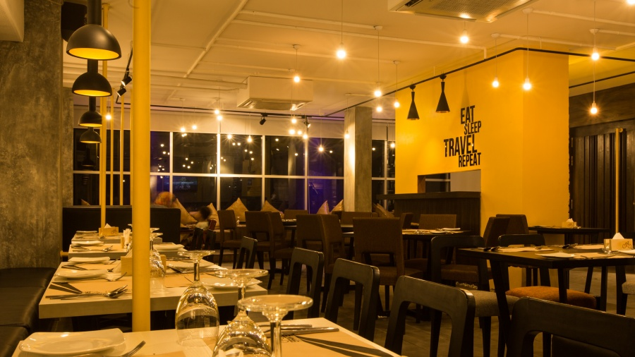 Dining spaces and the first massive yellow wall. Image Courtesy: Maruf Raihan