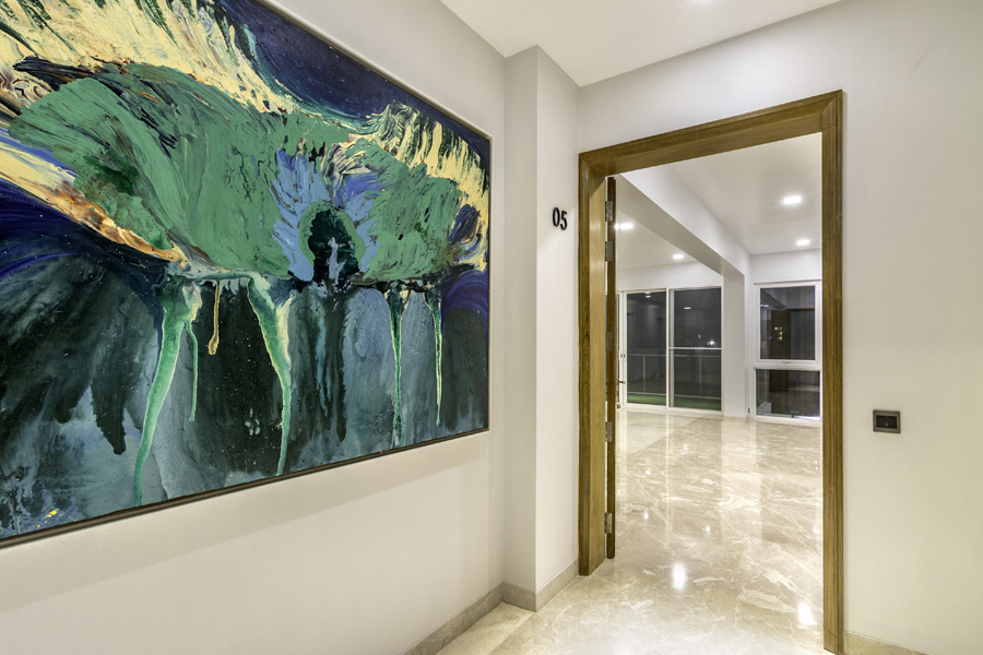 Paintings were hand-picked to give that extra depth to the foyer of each apartment | Photo credit : Meer Sadi