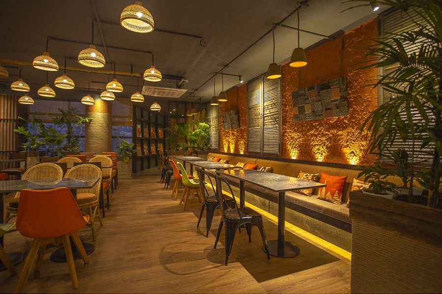The interior of Chef's Kitchen is starring recycled furniture and materials  © Zero Inch Interior's Ltd